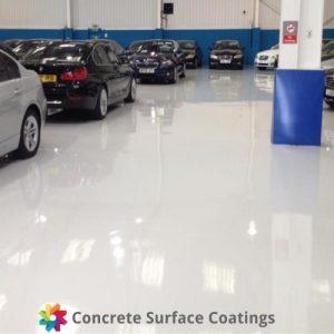 An epoxy floor coating in a car dealership
