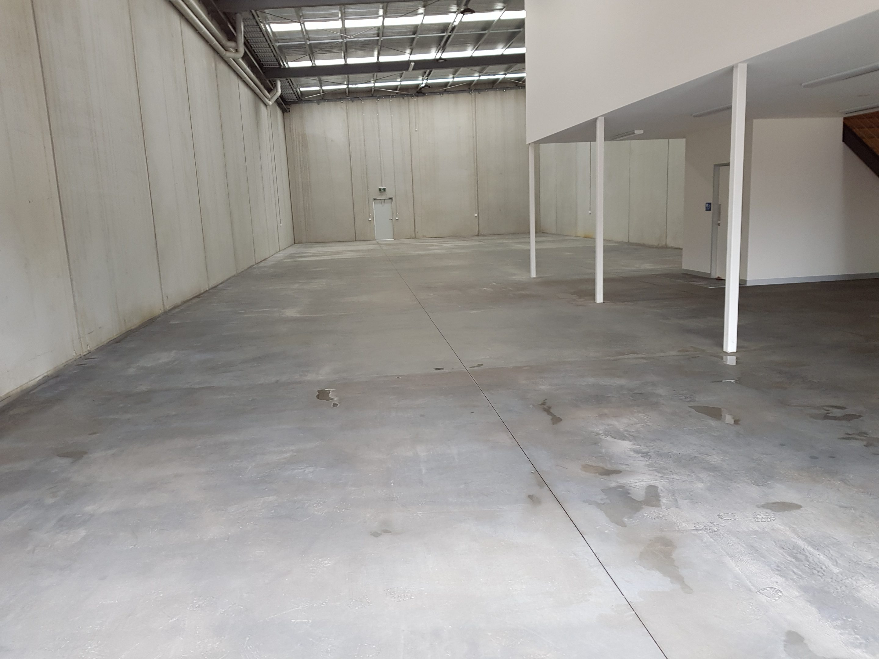 concrete floor being prepared for concrete sealer