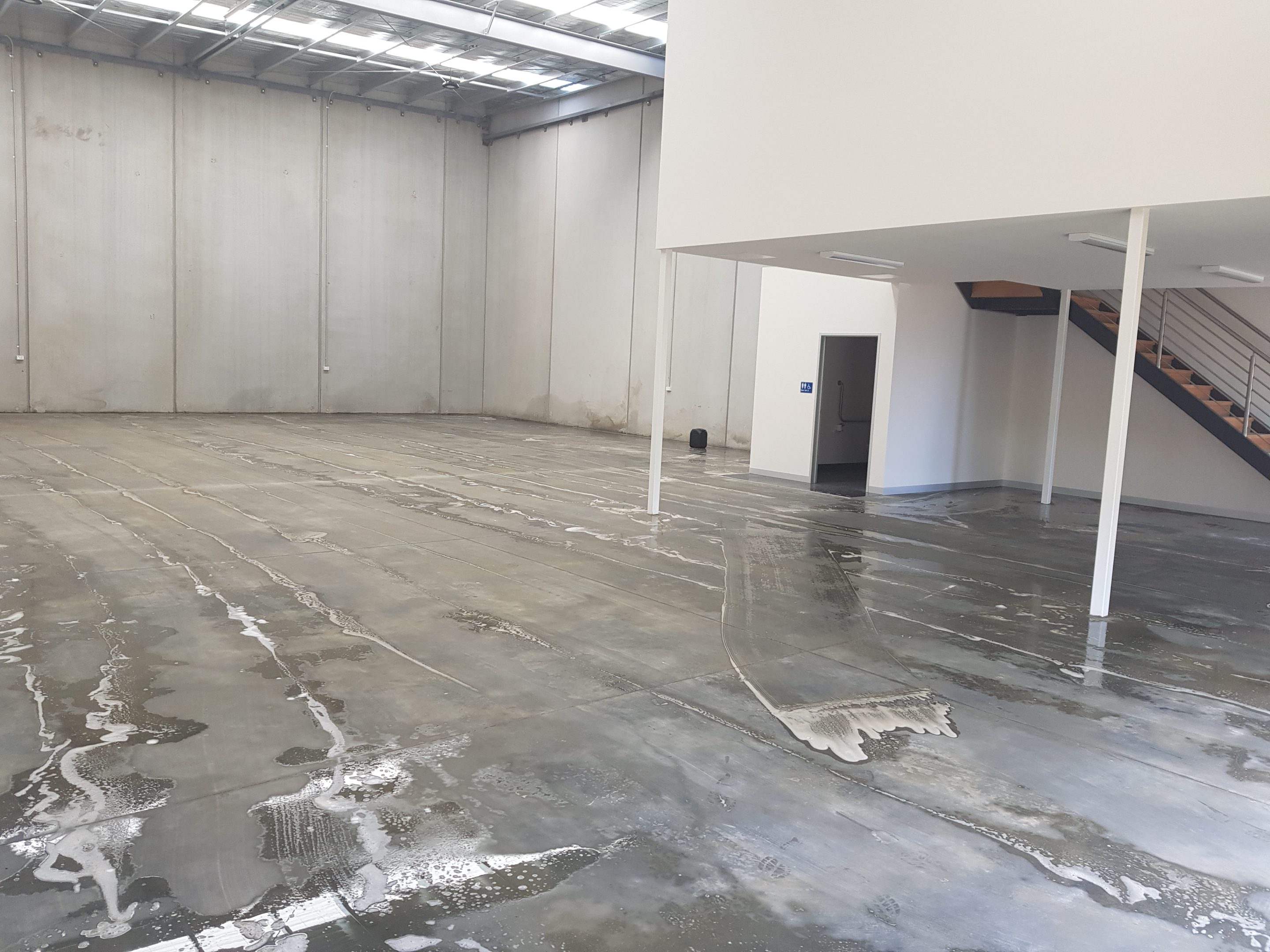 cleaning factory floor with hydrochloric acid
