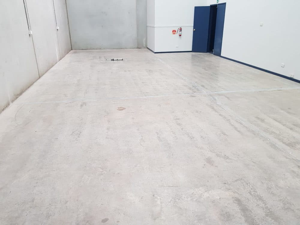 Epoxy floor coating in a Notting Hill automotive workshop 2